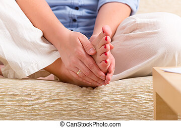 Woman practicing Reiki self healing - Woman practicing self...
