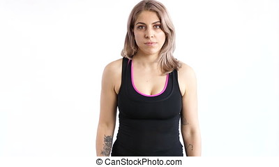 Woman practicing sport with dumbbells over white background...