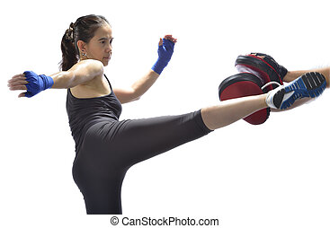 Woman practicing Thai boxing technique muay Thai