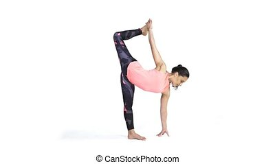 Woman practicing yoga Ardha Chandrasana - Young attractive...