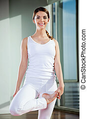 Woman Practicing Yoga At Gym
