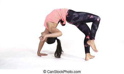 Woman practicing yoga Bridge pose - Young attractive woman...