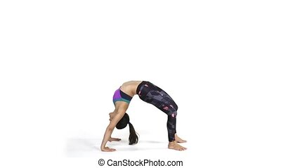Woman practicing yoga Bridge pose - Young attractive woman...