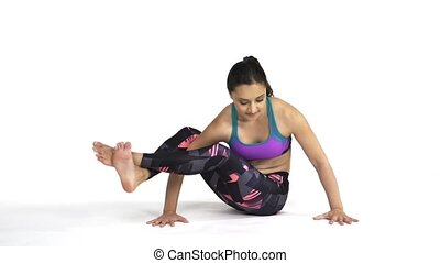 Woman practicing yoga Eight angled Pose - Young attractive ...