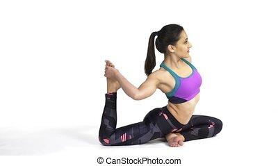 Woman practicing yoga Eka pada Rajakapotasana Pose