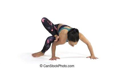 Woman practicing yoga Ekapada Yogadandasana Pose - Young...