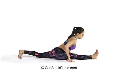 Woman practicing yoga Hanumanasana, Splits Pose - Young...
