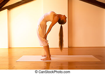 Woman practicing Yoga in a Attic