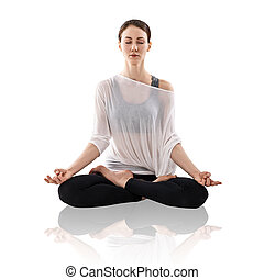 Woman practicing yoga in the lotus position