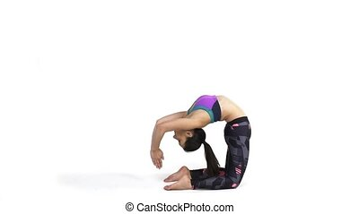 Woman practicing yoga Kapotasana, Pigeon Pose - Young...
