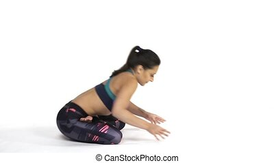 Woman practicing yoga Padma Mayurasana pose - Young...