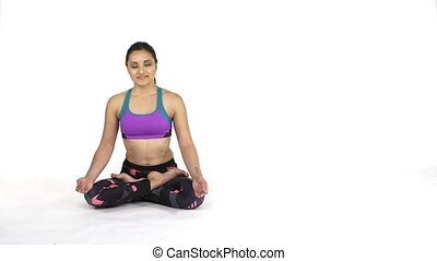 Woman practicing yoga Padmasana, lotus pose - Young...