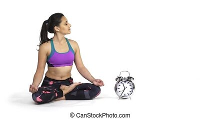 Woman practicing yoga Padmasana, lotus pose - Time for yoga...