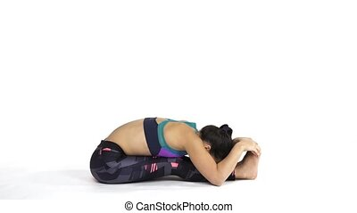 Woman practicing yoga Pashcimottanasana - Young attractive...