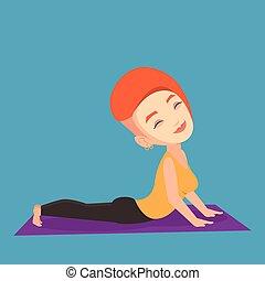 Woman practicing yoga upward dog pose.