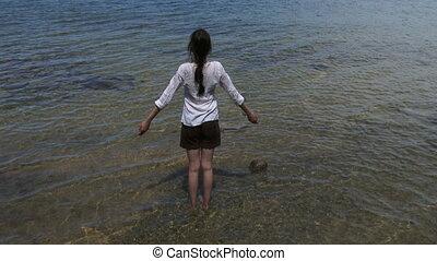 Woman practising yoga in a lake - Woman practising yoga...