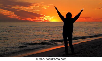 Woman Praising At Sunset