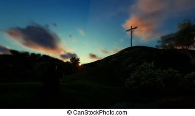 Woman praying at Jesus cross against beautiful sunset, panning