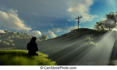 Woman praying at Jesus cross against beautiful sun rays,...