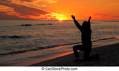 Woman Praying At Sunset