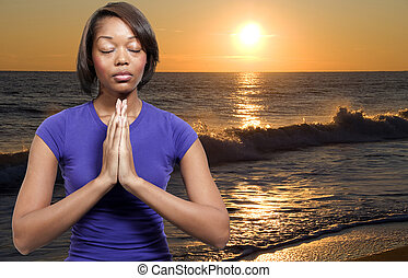 Woman praying - Beautiful Christian woman in deep prayer