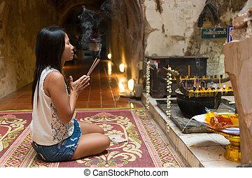Woman praying Buddha