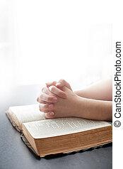 Woman praying on white background