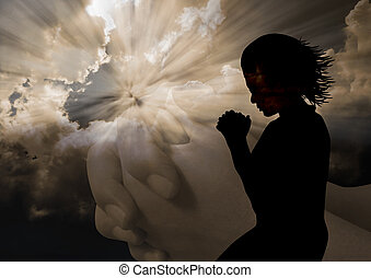 Woman praying silhouette - Woman kneel praying in silhouette