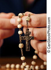 Woman praying with rosary to God