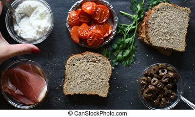 Woman prepares and arranges sandwich - Woman prepares and...