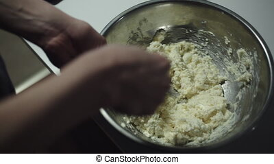 Woman prepares the dough for the cookies