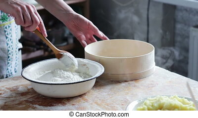 Woman Prepares the Dough on Domestic Kitchen