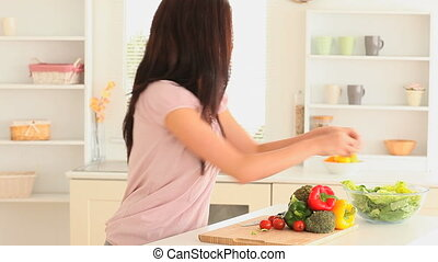 Woman preparing a salad