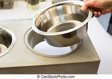 Woman preparing dog food bowl