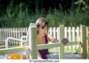 Woman preparing fence to be painted