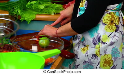 Woman preparing food 5 - Woman preparing food in the kitchen...