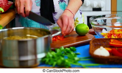 Woman preparing food 8 - Woman preparing food in the kitchen...
