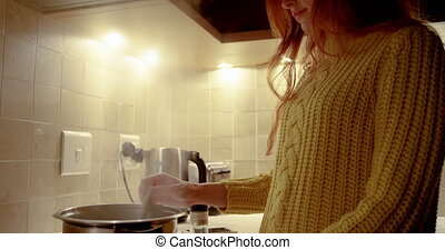 Woman preparing food in kitchen 4k - Beautiful woman...