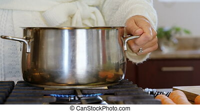 Woman preparing food in kitchen at home 4k