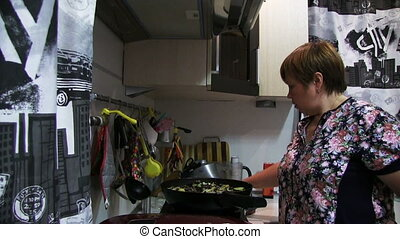Woman Preparing Food In The Pan