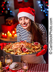 Woman preparing for Christmas dinner - Smiling woman with ...