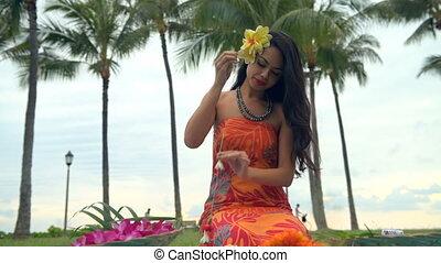 Beautiful woman preparing garland in the garden 4k