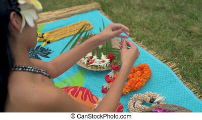 Woman preparing garland in the garden 4k - Young woman...