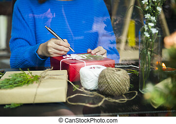 Woman preparing gifts for Christmas