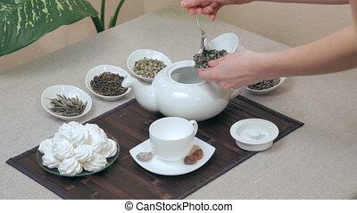 Woman preparing green tea