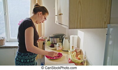 Woman Preparing Healthy Food in the Kitchen