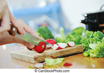 healthy food - woman preparing healthy food salad with green...