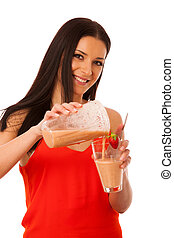 Woman preparing healthy fresh fruit smoothie.
