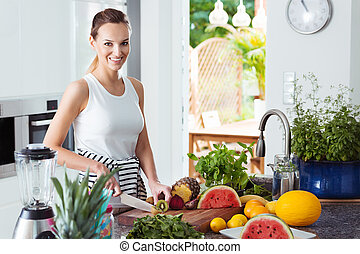 Woman preparing healthy fruit salad