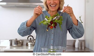 Woman preparing healthy salad in slow motion